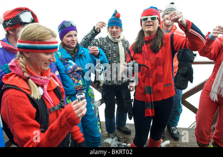 Slovakia, Jasna, group of instructors dressed up to the eighties celebrating the end of the season - Stock Photo
