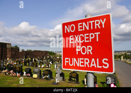 Sign in a graveyard 'No entry except for funerals' - Stock Photo