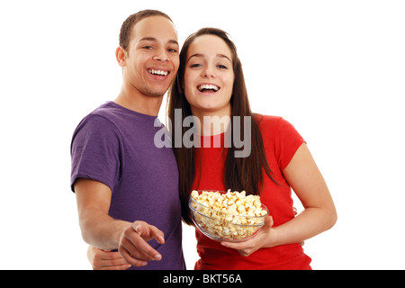 Laughing at a funny film holding popcorn - Stock Photo