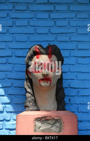 A statue of a woman that has been vandalized with graffiti paint - La Boca, Buenos Aires, Argentina - Stock Photo