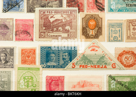 A collection of old postage stamps - Stock Photo