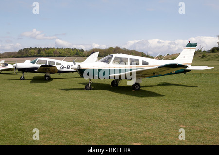 Light aircraft at Popham Airfield, Hampshire, England at a 'Fly-In' on Monday 3rd May 2010. - Stock Photo