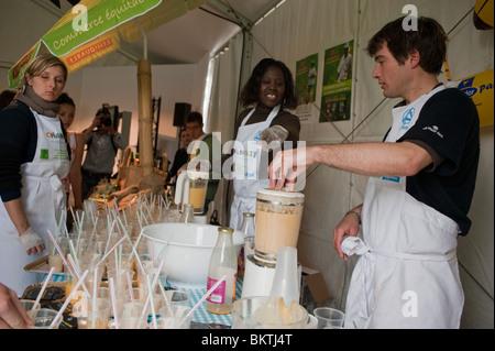 Celebration of World 'Fair Trade' Day, La Villette Park, Teenagers Distributing Fair Trade Fruit Drinks, Food Festival - Stock Photo