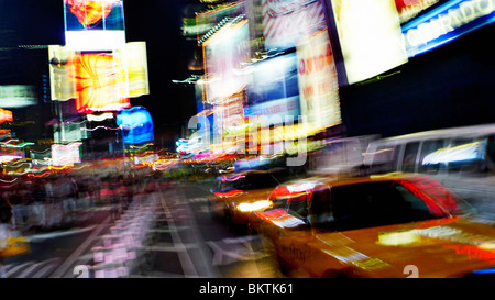 Blurring lights of downtown Times Square, New York City, USA. - Stock Photo