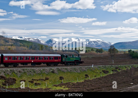 The Strathspey steam Railway between Boat of Garten and Aviemore with the Cairngorms mountains.  SCO 6190 - Stock Photo