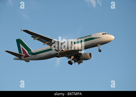 An Air Italia Airbus A320 coming in to land at London Heathrow, UK.  August 2009. (EI-DTG) - Stock Photo
