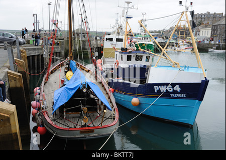 Fishing boats docked in Padstow harbour Cornwall - Stock Photo