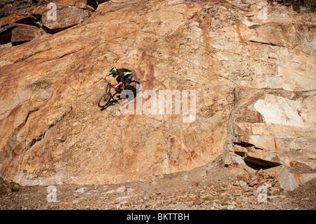 Downhill Mountain Biking in the world famous Whistler Bike Park in Whistler, BC, Canada - Stock Photo