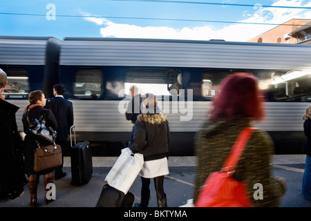 People waiting for train on platform - Stock Photo