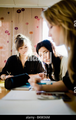 Three pupils working together - Stock Photo
