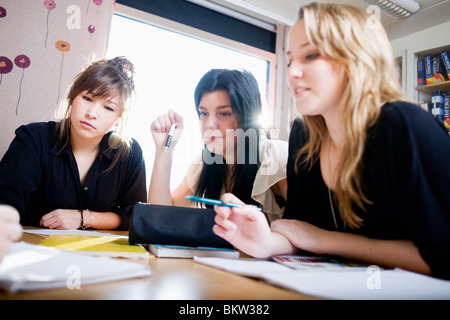 Three concentrated girls - Stock Photo