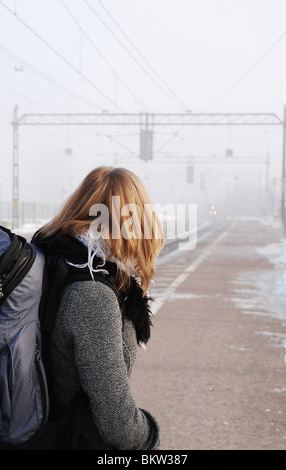 Woman waiting for train - Stock Photo