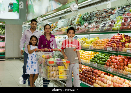 Family at supermarket, portrait - Stock Photo