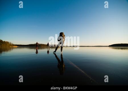 Three people long-distance skating - Stock Photo
