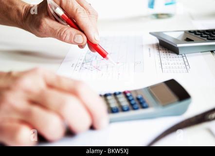 Closeup hand and calculator - Stock Photo