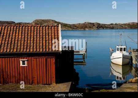Boathouse and boat - Stock Photo