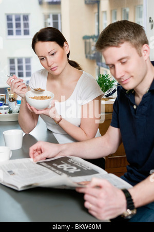 Coulple eating breakfast - Stock Photo