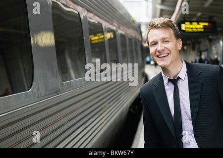 Businessman waiting on station - Stock Photo