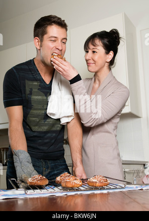 Woman and man in kitchen - Stock Photo