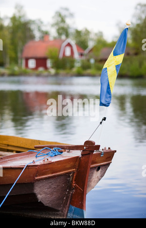 Boat, house and flag - Stock Photo