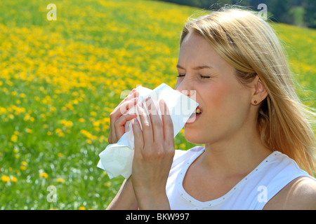 Women with pollen allergy in a Spring Meadow - Stock Photo
