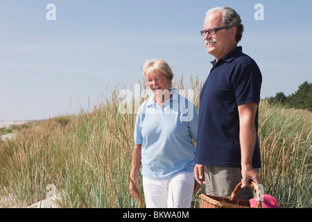 Woman and man on the beach - Stock Photo