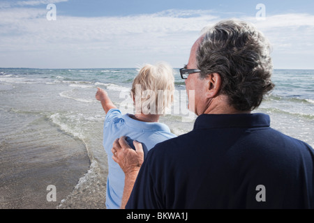 Woman and man by the water - Stock Photo