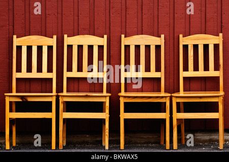Four chairs in a row - Stock Photo