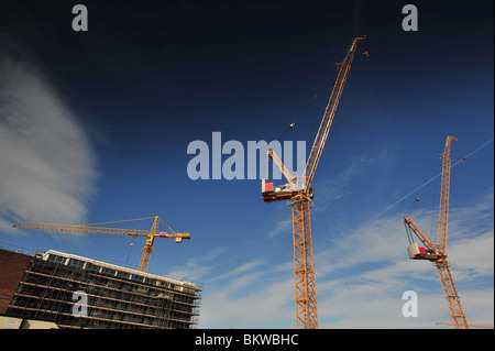 Construction crains on building site. - Stock Photo