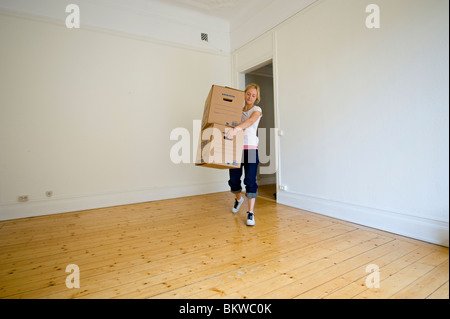 Woman with moving boxes - Stock Photo