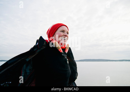 Woman in red cap - Stock Photo