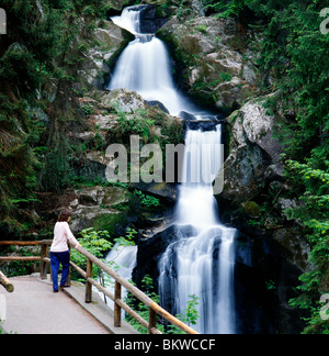 Female tourist viewing the Triberg Waterfalls, highest waterfalls in Germany (Black Forest). - Stock Photo