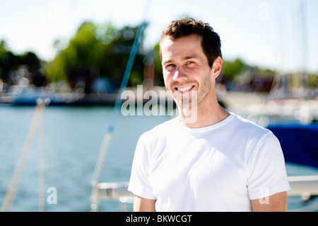 Man in white t-shirt - Stock Photo