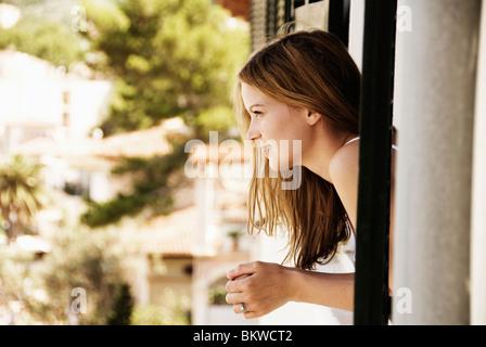 Girl in window - Stock Photo