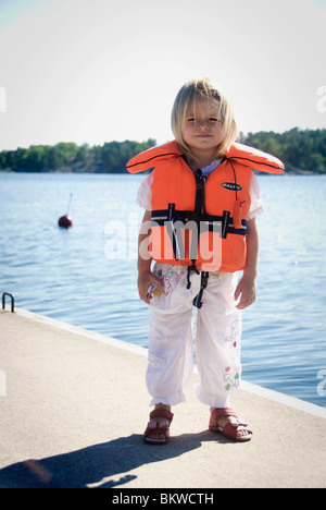 Girl in life jacket - Stock Photo