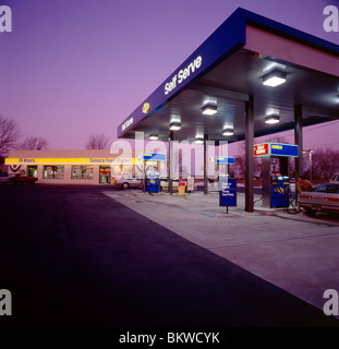 Dusk view of a gasoline station and convenience store - Stock Photo