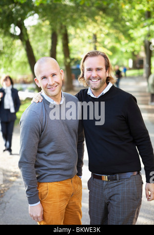 Two happy men standing outside - Stock Photo