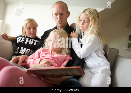 Father with three daughters - Stock Photo