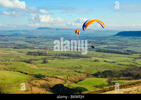Paraglider above the Loud Valley, Lancashire, England, seen from the launch site on Parlick with Pendle Hill in - Stock Photo