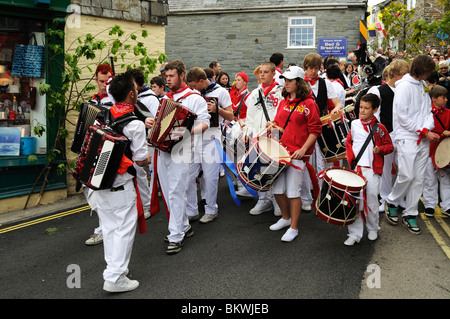 teenagers playing music and leading the parade on obby oss day in padstow, cornwall, uk - Stock Photo
