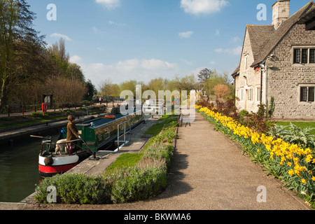 Narrowboat navigating Iffley lock on the River Thames in spring near Oxford, Uk - Stock Photo
