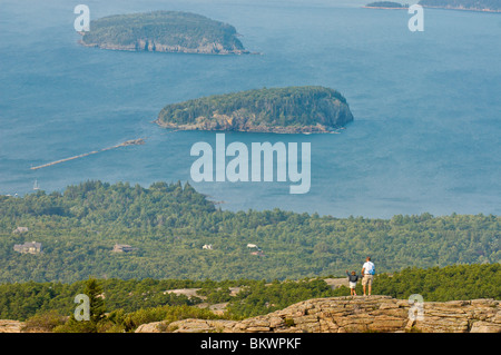 Stock photograph of man and daughter on Cadillac Mountain viewing Porcupine Island in Bar Harbor,Acadia National - Stock Photo