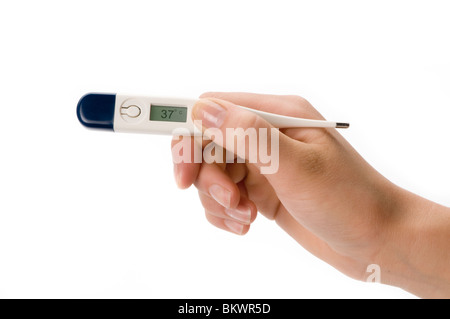 hand holding thermometer - Stock Photo