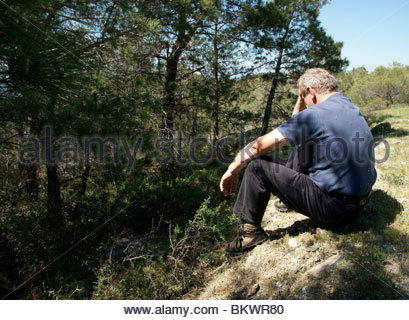 Greek man resting during a hike Greece - Stock Photo