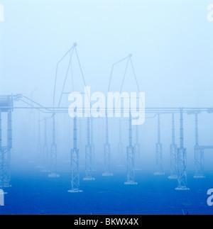 Foggy, misty, electrical transmission yard at dawn, Limerick Nuclear Power Plant, Limerick, Pennsylvania, USA - Stock Photo
