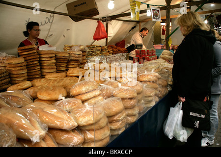 Bread and simits at the Turkish market at Maybachufer in eastern Kreuzberg, Berlin, Germany - Stock Photo