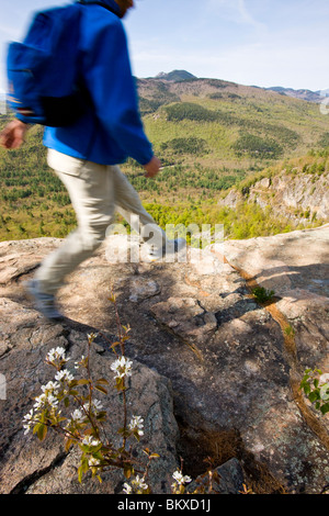 A hiker on the Boulder Loop Trail in New Hampshire's White Mountains.  White Mountain National Forest. - Stock Photo