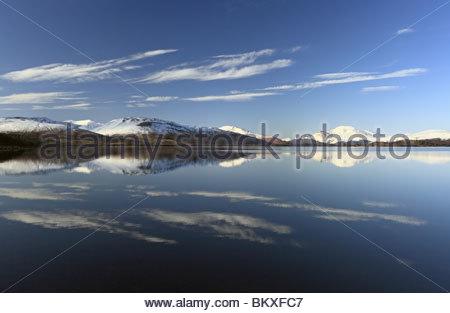 Loch reflections on Loch lomond - Stock Photo