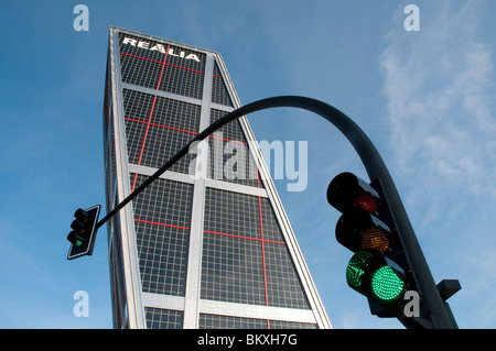 KIO Tower and green traffic light, view from below. Madrid, Spain. - Stock Photo