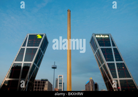 KIO Towers and Calatrava obelisk at dusk, Plaza de Castilla. Madrid, Spain. - Stock Photo